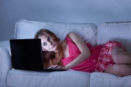 Sleepless girl surfing the internet