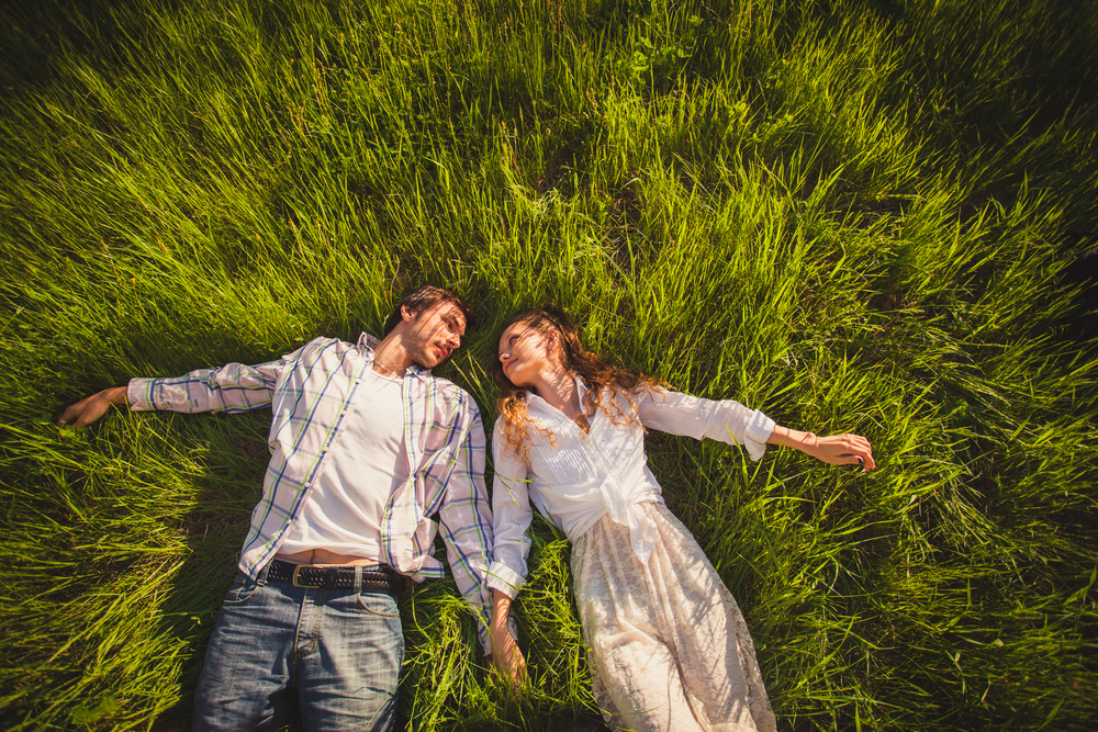 couple in love lying on grass