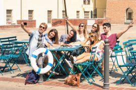 Group of happy best friends taking a selfie - Tourists having fu