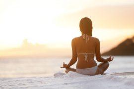 Meditation - Yoga woman meditating at beach sunset