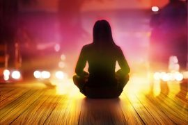 women are meditating at night and rays of light  in the city