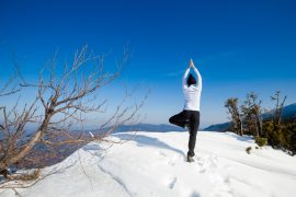 Winter yoga session in beautiful mountain place
