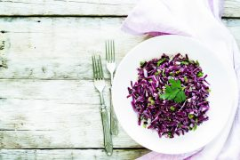 salad of red cabbage with onions and greens