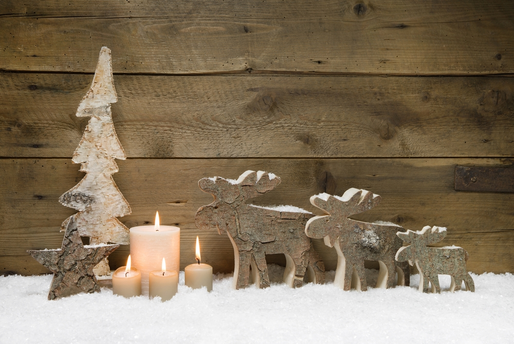 Wooden Christmas tree with elk or reindeer, four candles on wood