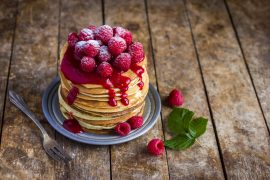 pancakes with fresh raspberry and powdered sugar
