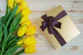 Yellow tulips on a wooden surface