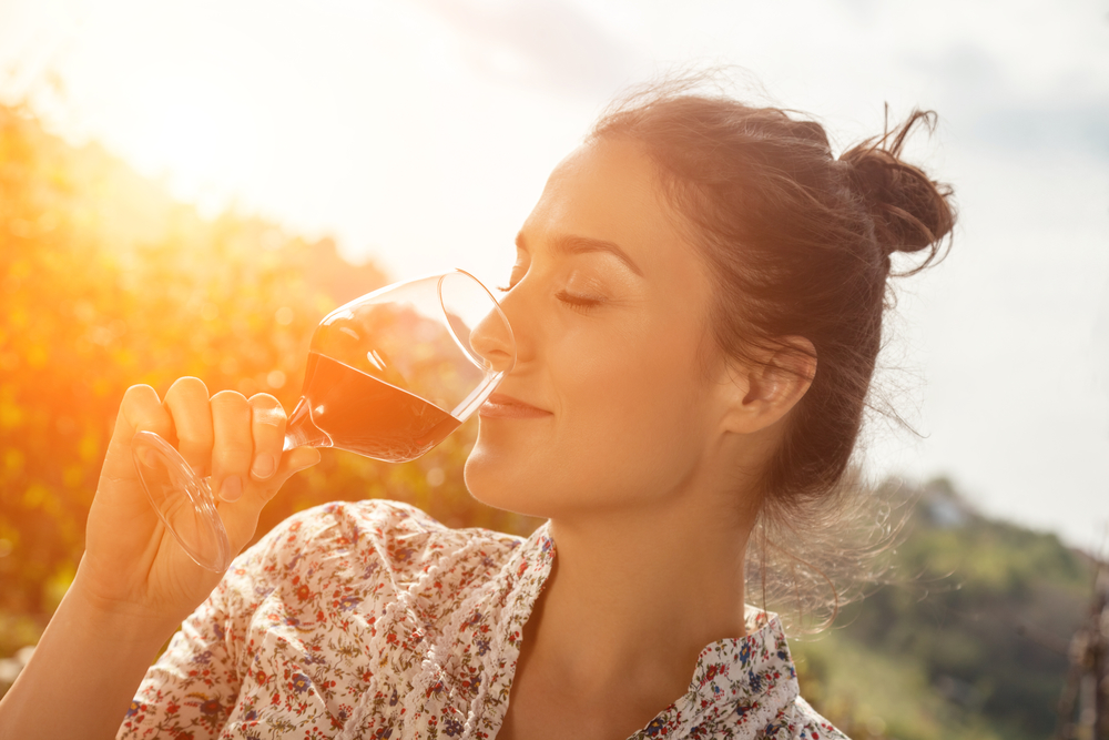 Young Woman Drinking Wine