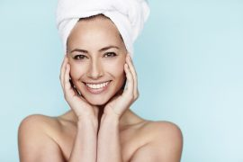 Smiling woman in towel
