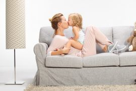Young beautiful mother playing with daughter