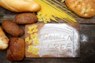 gluten free  word with bread on wood