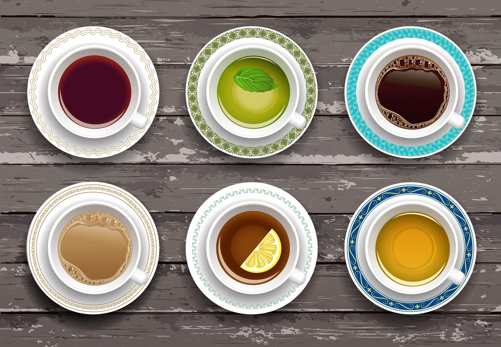 Set of cups of coffee and tea. Wooden background