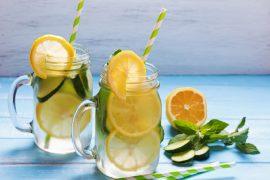 Lemon and cucumber detox water in glass jars