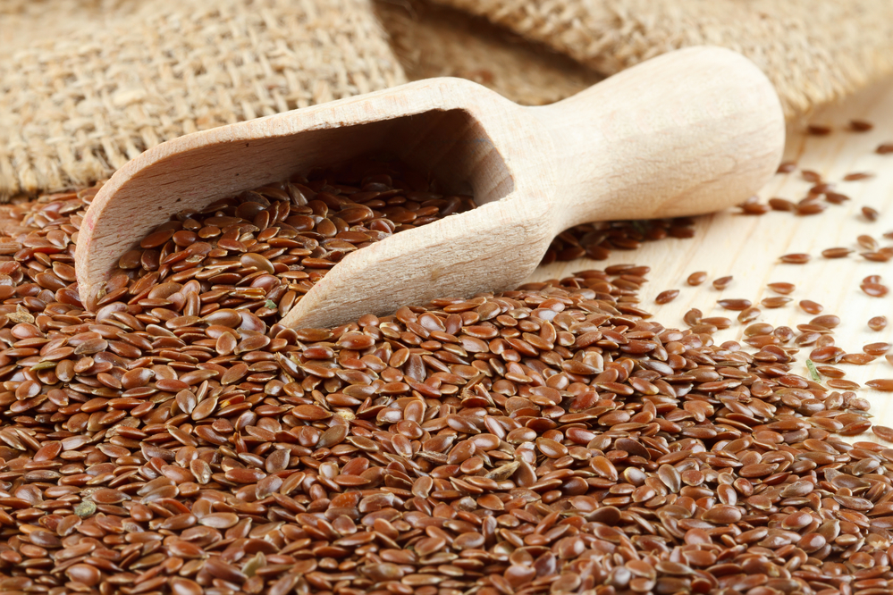 linseed, flax seeds, wooden scoop, hessian bag