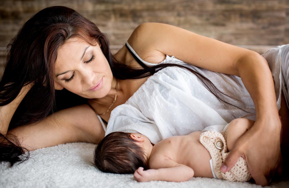 beautiful mother feeding her newborn