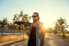 guy on skateboard at sunset