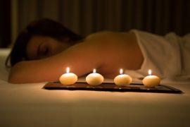 woman relaxing in spa salon in the dark