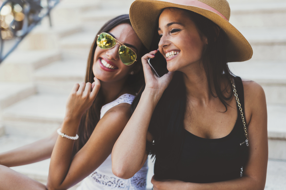 Attractive women talking on phone and smiling