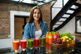 Diet Nutrition. Woman With Fresh Juice Smoothie In Kitchen