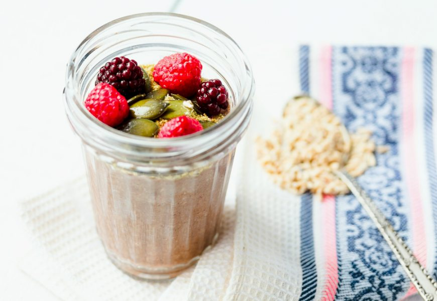 Oatmeal chocolate mousse with berries and pumpkin seeds