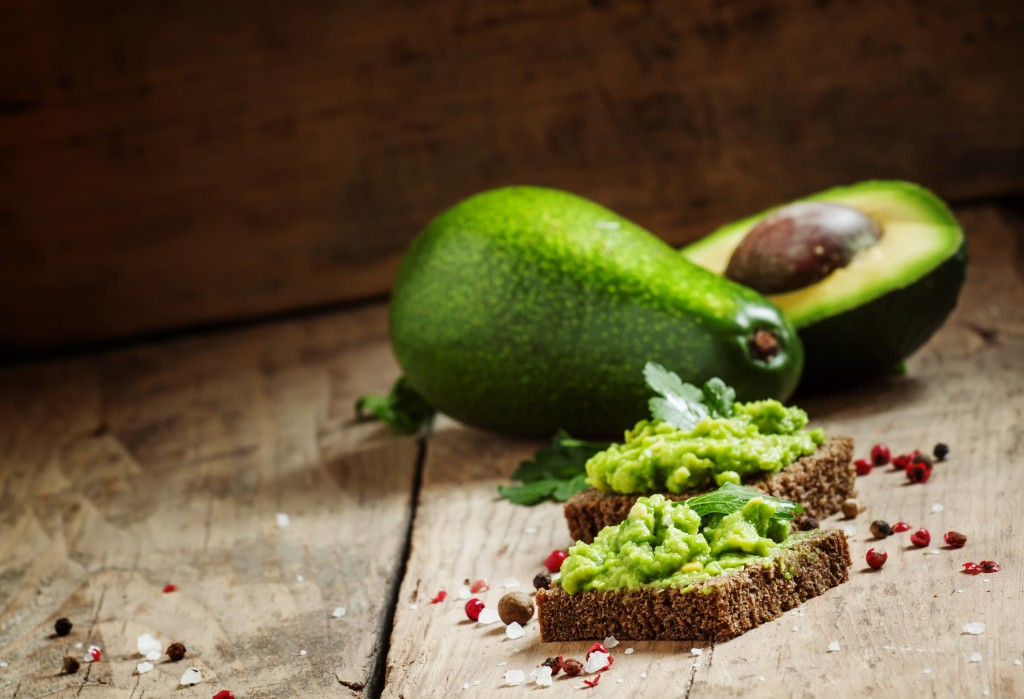 Sandwiches with black rye bread and avocado mousse with spices,