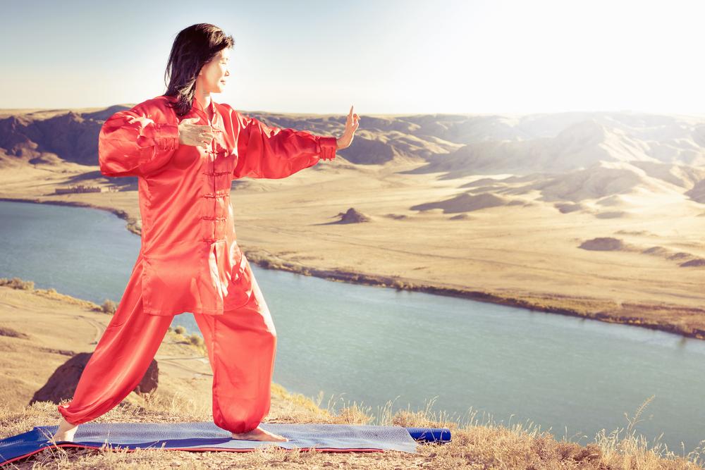 Mature asian woman doing kundalini yoga