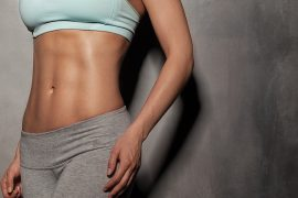 Fitness female woman with muscular body, do her workout, abs