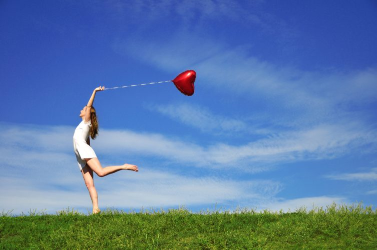 girl with a red ball in the form of heart