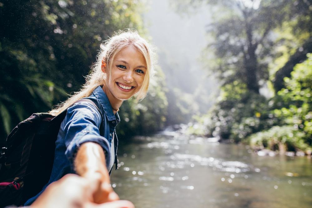 Female hiker holding hand of his boyfriend